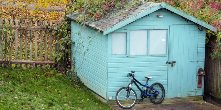 bike in front of a shed