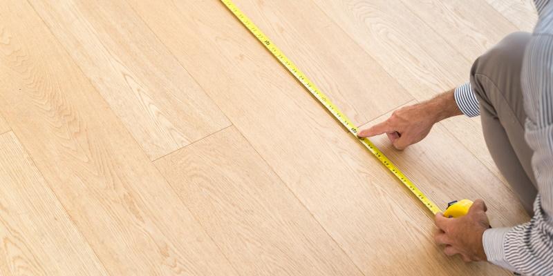 Architect measureing floor